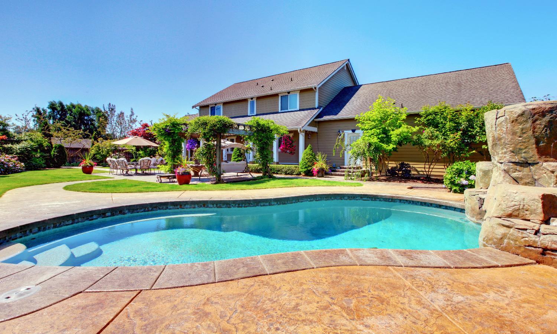 house with grey shingles and backyard pool